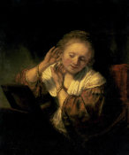 Rembrandt - Young Woman Trying Earrings, 1654