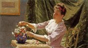 Emile Claus - A Young Woman Arranging Flowers