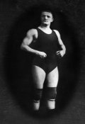 Vintage Muscle Men - Bodybuilder in Wrestling Outfit and Knee Pads