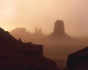 Tim Fitzharris - Sandstorm enshrouding mittens, Monument Valley, Arizona