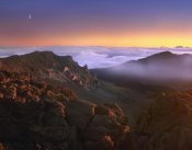 Tim Fitzharris - Sunrise and crescent moon overlooking Haleakala Crater, Maui, Hawaii