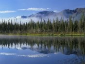 Tim Fitzharris - Lake reflecting mountain range and forest, Kluane National Park, Yukon, Canada