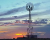 Tim Fitzharris - Windmill producing electricity at sunset example of renewable energy, North America