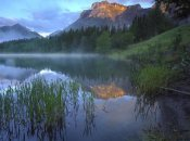 Tim Fitzharris - Morning light on Mt Kidd, mist rising from water, Kananaskis Country, Alberta, Canada