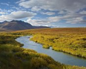 Tim Fitzharris - North Klondike River flowing through tundra beneath the Ogilvie Mountains, Yukon Territory, Canada