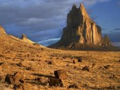 Tim Fitzharris - Shiprock, the basalt core of an extinct volcano, tuff-breccia ejected boulders in foreground, New Mexico