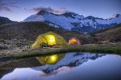 Colin Monteath - Campers read in tents lit by flashlight, Cascade Saddle, Mount Aspiring National Park, New Zealand