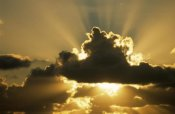 Aad Schenk - Sun rays beam from behind cumulus clouds