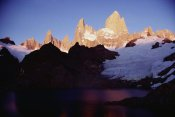 Tui De Roy - Sunrise glow on high granite spires, Fitzroy Massif, Los Glaciares NP, Argentina