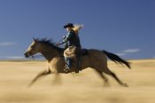 Konrad Wothe - Cowgirl on Horse running through field, Oregon