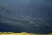 Gerry Ellis - Storm clouds over hills, Grasslands National Park, Canada