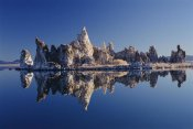 Gerry Ellis - Mineral tufa formations reflected in Mono Lake, California