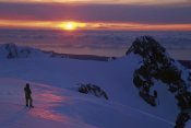 Colin Monteath - Skier on Franz Josef Glacier watching sunset over the Tasman Sea, Westland NP