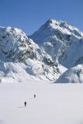 Colin Monteath - Skiers cross frozen Lake Harris, Routeburn Track, Mt Aspiring NP, New Zealand