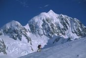 Colin Monteath - Skiier nearing Von Bulow Peak, Mount Tasman behind, Westland NP, New Zealand