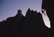 Lionel Clay - Climber silhouetted on Chain Reaction, Smith Rocks, Oregon