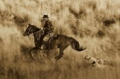 Konrad Wothe - Cowboy riding Horse, followed by two Dogs , Oregon - Sepia