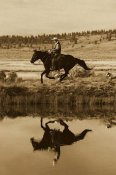 Konrad Wothe - Cowboy riding Horse beside pond with two dogs, Oregon - Sepia