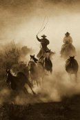 Konrad Wothe - Horses herded by cowboy and cowgirl, Oregon - Sepia