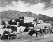 Ansel Adams - Full view of city, mountains in background, Taos Pueblo National Historic Landmark, New Mexico, 1941