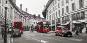 Pangea Images - Buses and taxis in Oxford Street, London