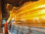 Pangea Images - Praying the reclined Buddha, Wat Pho, Bangkok, Thailand