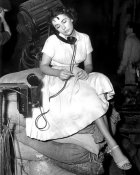 Hollywood Photo Archive - Elizabeth Taylor on the phone backstage