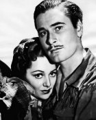 Hollywood Photo Archive - Errol Flynn with Ann Sherdian in Dodge City