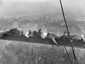 Unknown - Construction Workers Resting on Steel Beam Above Manhattan, 1932