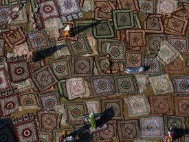 Yann Arthus-Bertrand - Colorful Carpets Drying on the Ground, India