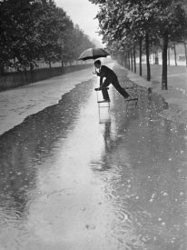 Anonymous - Man crossing puddle on chairs, 1934