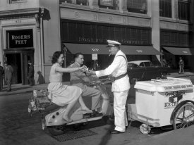Anonymous - Couple on Motor Scooter Buying Ice Cream Bar, 1954