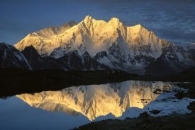 Colin Monteath - Mt Makalu and Mt Chomolonzo bathed in dawn light, reflected in small lake, Khama Valley, Tibet
