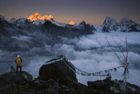 Colin Monteath - Mountaineer enjoying the view of Mt Everest and the Himalayan Mountains at sunset from Gokyo Ri, Khumbu, Nepal