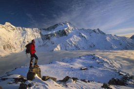 Colin Monteath - Mt Sefton, climber at dawn above Mueller hut and cloud-filled Mueller Glacier, Mt Cook National Park, New Zealand