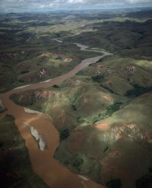 Konrad Wothe - Deforested and deeply eroded hills alongside silted river, Betsiboka River, Madagascar