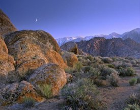 Tim Fitzharris - Crescent moon rising over Sierra Nevada seen from Alabama Hills, California