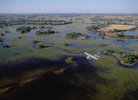 Konrad Wothe - Safari airplane flying over the flooded Okavango Delta, Botswana