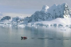 Konrad Wothe - Tourists in zodiac boat with snow covered landscape, Paradise Bay, Antarctica