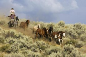 Konrad Wothe - Cowboys herding a Horse group through Sagebrush, Oregon