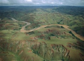 Konrad Wothe - Deforested and eroded hills along silted Betsiboka River, Madagascar