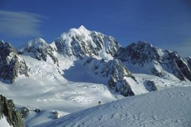 Colin Monteath - Ski mountaineer near summit with Mt Tasman behind, Westland NP, New Zealand