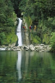 Colin Monteath - Hikers on bridge, Giant's Gates Falls, Milford Track, New Zealand