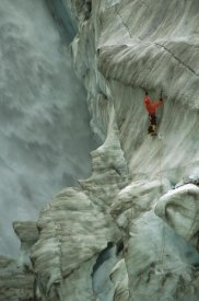Colin Monteath - Ice climber in Fox Glacier crevasse near Victoria Falls, Westland NP, New Zealand