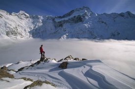 Colin Monteath - Mt Sefton, climber above cloud-filled Mueller Glacier, Mt Cook NP, New Zealand