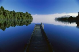 Andy Reisinger - Wood dock reaching out into Lake Mapourika, South Island, New Zealand