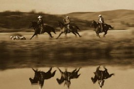 Konrad Wothe - Cowboys riding Horses with dogs running beside pond, Oregon - Sepia