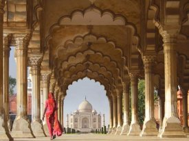 Pangea Images - Woman in traditional Sari walking towards Taj Mahal