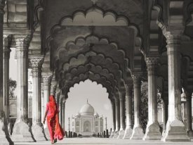 Pangea Images - Woman in traditional Sari walking towards Taj Mahal (BW)