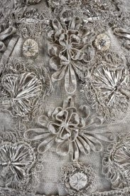 Unknown Swedish Needleworker - Detail of elaborate silver embroidery on a child's bonnet